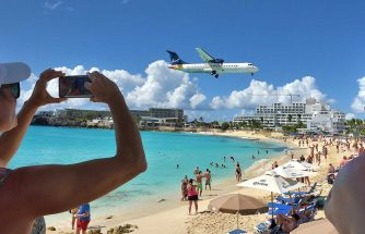 Liat Airlines landing over Maho Beach
